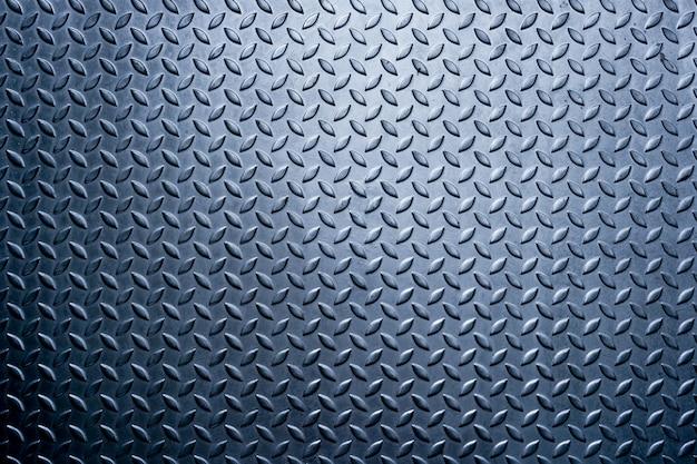 Un fondo de patrón de placa de diamante de metal, fondo de textura de metal Foto Premium
