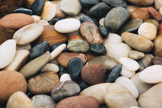 Fondo de la pila de los riverstones, piedras redondas hermosas. Foto gratis