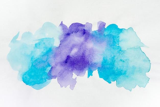 Fondo de pintura de manchas de acuarela azul y violeta Foto gratis