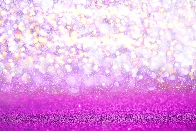 Fondo púrpura del extracto del bokeh de la textura de las luces del brillo. desenfocado Foto Premium