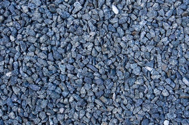 Fondo de la roca triturada para la construcción. Foto Premium