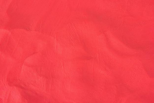 Fondo rojo plastilina con textura Foto Premium