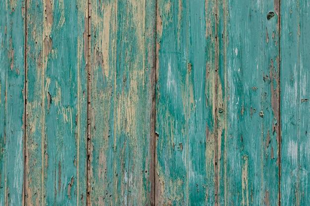 Fondo de tablón antiguo rústico en turquesa, colores menta con texturas rasguños y pintura agrietada antigua Foto Premium