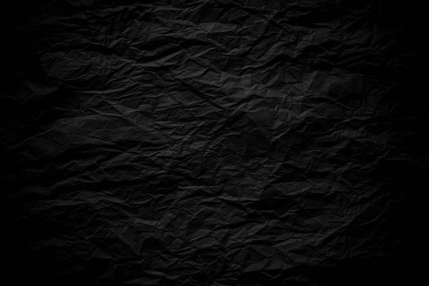 Fondo de textura de papel arrugado negro oscuro cerca Foto Premium