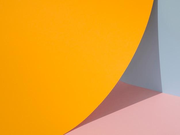 Formas de papel abstracto naranja con sombra Foto gratis