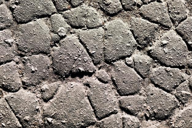 Fragmento de una pared de una piedra astillada Foto gratis