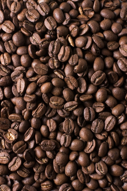 Frijoles tostados de fondo de café de buen gusto Foto gratis