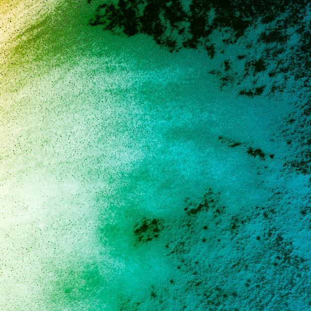 Gradiente de color líquido con espuma Foto gratis