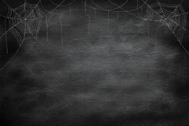 Grupo de dibujo de telaraña en la esquina sobre fondo vintage retro pizarra para fiesta de noche de halloween Foto Premium