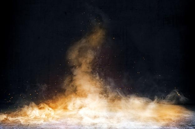 Habitación con piso de concreto y humo con fondo de chispas de fuego Foto Premium