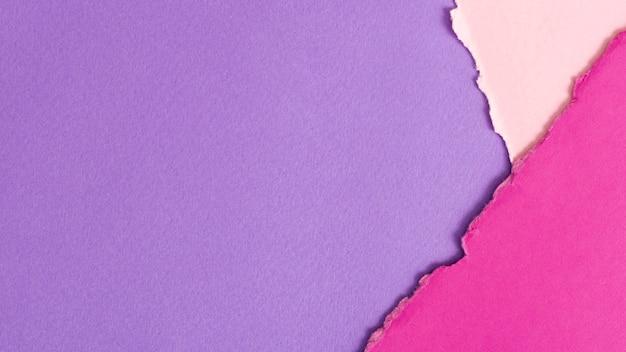 Hojas de cartón en tonos púrpura con espacio de copia Foto gratis