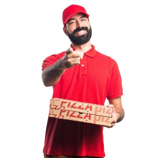 Hombre de entrega de pizza apuntando hacia el frente   Descargar ...
