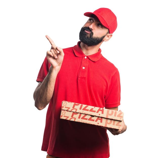 Hombre de la entrega de pizza pensando   Descargar Fotos gratis