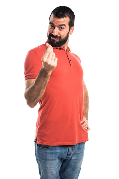 055155d4e71fe Hombre guapo haciendo un gesto de dinero