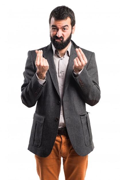 Hombre haciendo un gesto de dinero Foto gratis