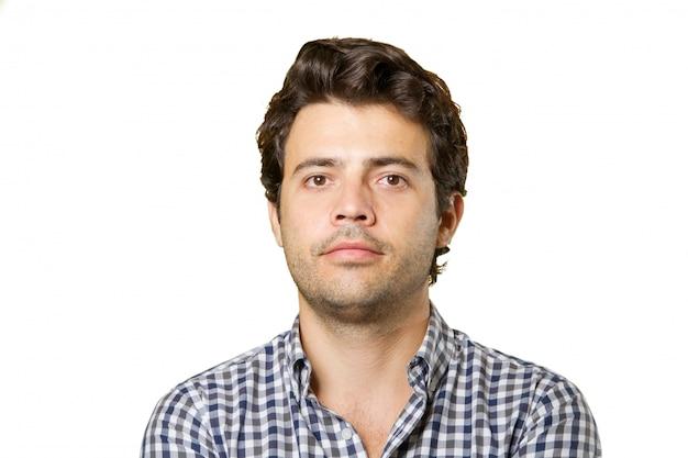 Hombre joven aislado cara neutral | Foto Premium