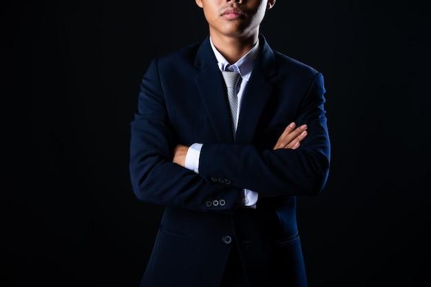 Hombre de negocios guapo joven gris Foto gratis