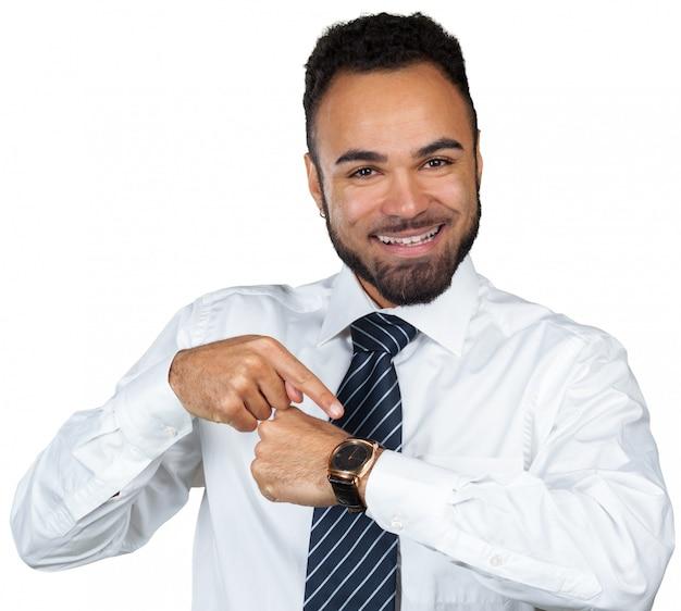 Hombre de negocios que señala en el tiempo de servicio Foto Premium