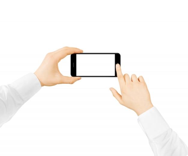 Hombre sostenga el teléfono maqueta de pantalla en blanco dos manos Foto Premium