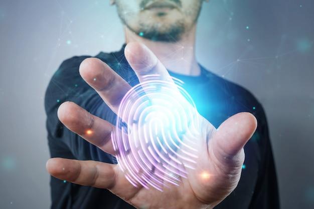 Huella digital de holograma, tecnología de información de mano masculina ciberseguridad Foto Premium