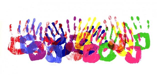 Huellas de manos borde multicolor Foto gratis