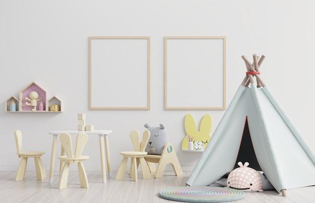 Interior, sala de niños, marco en blanco de la pared, guardería. Foto Premium