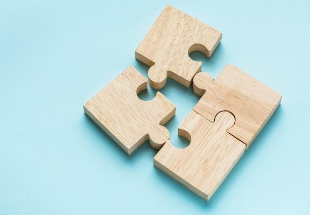 Jigsaw trabajo en equipo concepto macro tiro Foto gratis