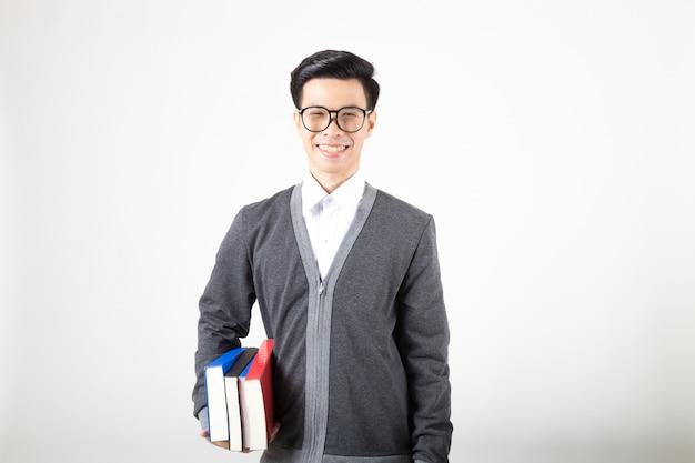 Joven estudiante graduado de asia con accesorios de aprendizaje. Foto Premium