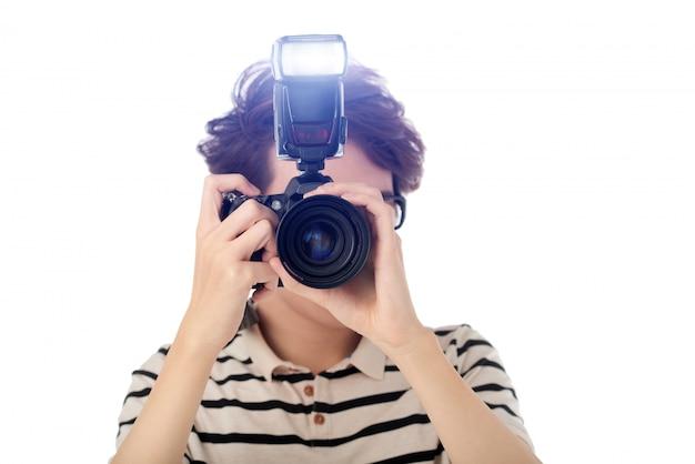 Joven fotógrafo Foto gratis