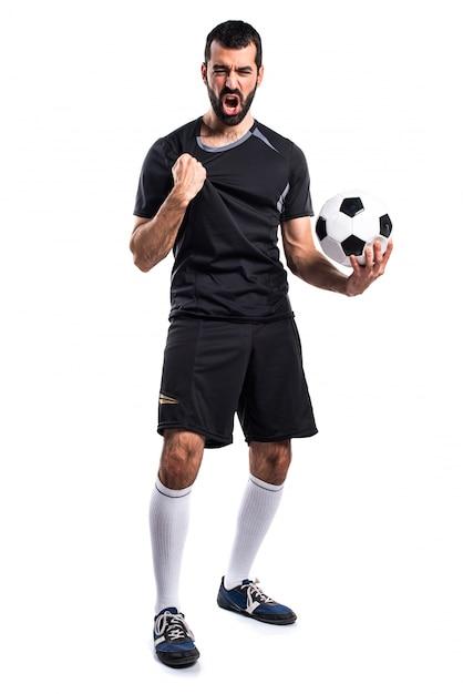 Jugador de fútbol afortunado Foto gratis