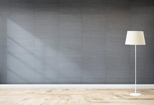 Lámpara de pie en una habitación gris. Foto gratis