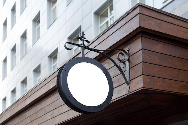 Letrero de tienda circular mínimo en blanco Foto Premium