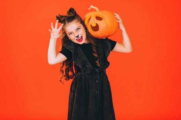 Linda chica vestida con traje de halloween en estudio Foto gratis