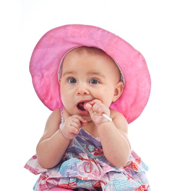 Linda niña pequeña con lollipop Foto Premium