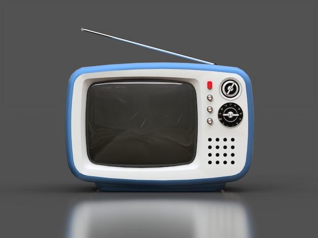 Lindo viejo televisor azul con antena sobre una superficie gris Foto Premium