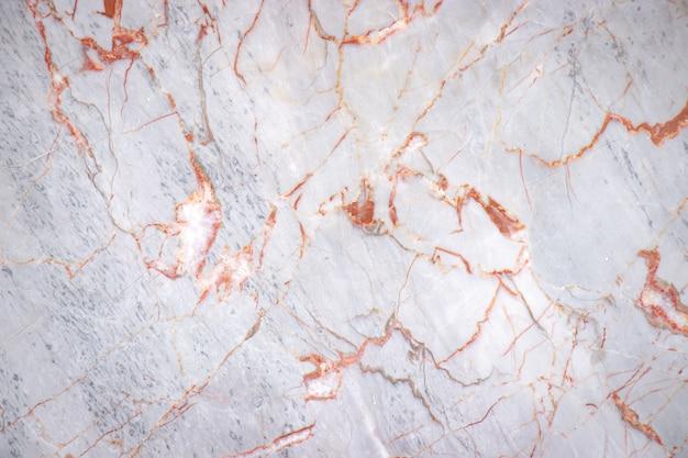 Losa de mármol agrietada blanca con fondo de textura de patrón de color cobre, detalle del antiguo piso de arquitectura Foto Premium