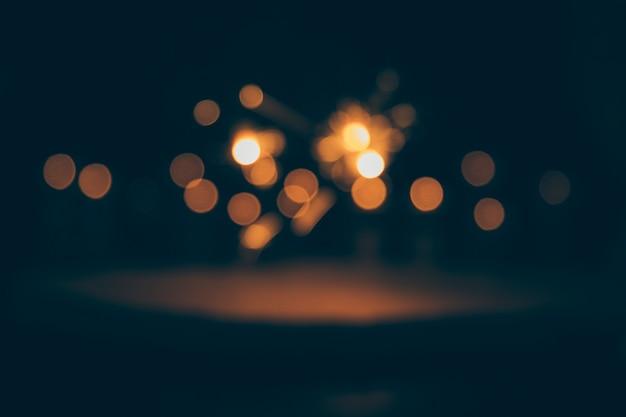 Luces abstractas del bokeh en fondo oscuro Foto Premium