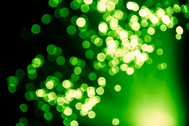 Luces verdes desenfocadas de fibra óptica Foto gratis