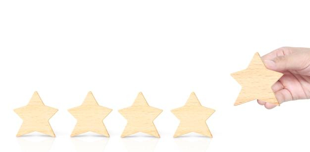 Madera de cinco estrellas en forma de mano. los mejores servicios empresariales excelentes Foto Premium