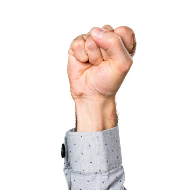 Mano del hombre con su puño cerrado Foto Gratis