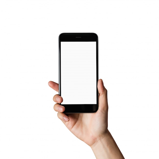Mano que sostiene la pantalla en blanco del teléfono inteligente en aislado. Foto Premium