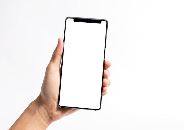 Mano que sostiene el teléfono móvil y la pantalla en blanco para la plantilla de maqueta Foto Premium