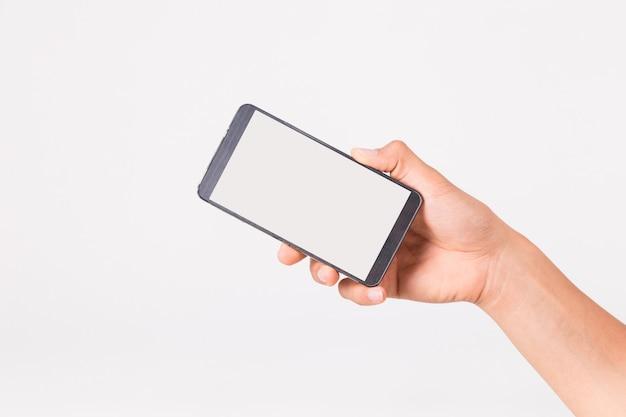 Mano sosteniendo el teléfono inteligente Foto Premium