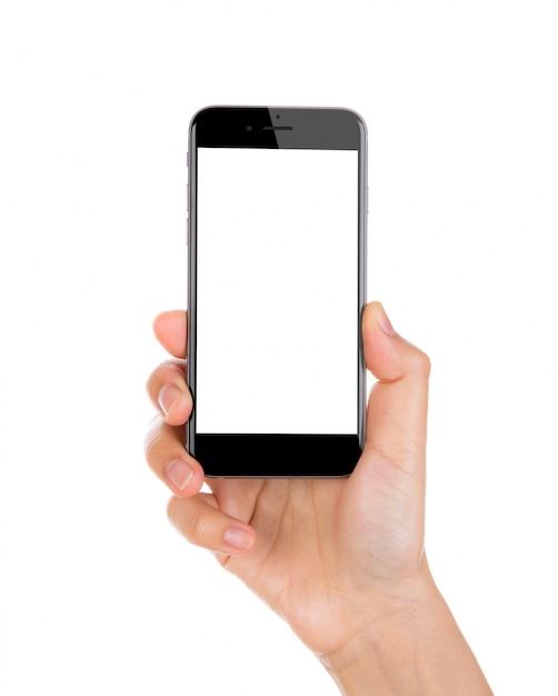 Mano sujetando un smartphone con la pantalla en blanco Foto Gratis
