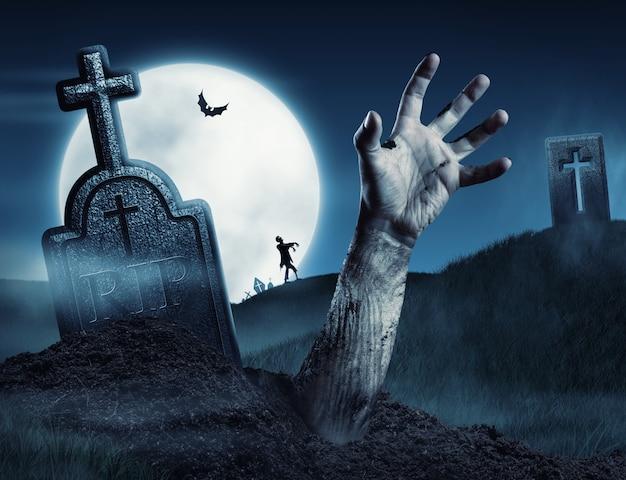 Mano de zombie saliendo de su tumba | Foto Premium