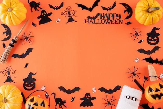Manualidades de halloween sobre fondo naranja con espacio de copia. Foto Premium