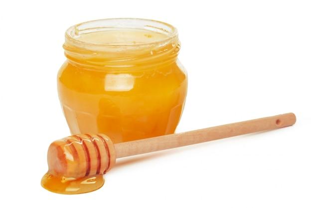 Manzanas y tarro de miel para vacaciones de año nuevo judío aislado Foto Premium