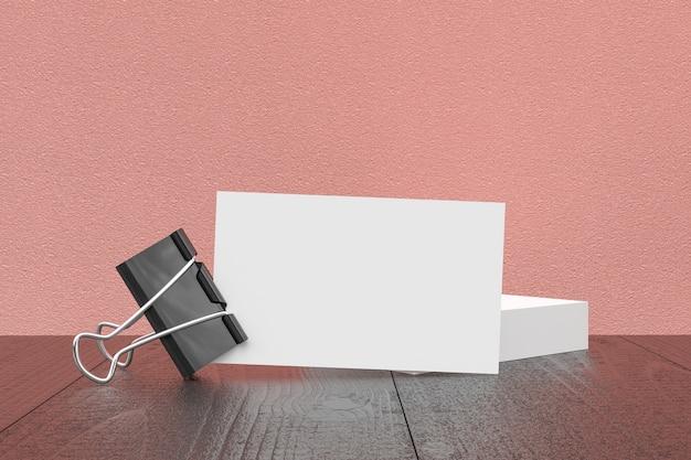 Maqueta, tarjeta de visita en blanco en el escritorio de trabajo Foto Premium