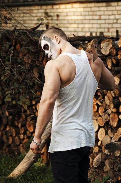 Maquillaje masculino del cráneo del azúcar. arte de la pintura de la cara. Foto Premium
