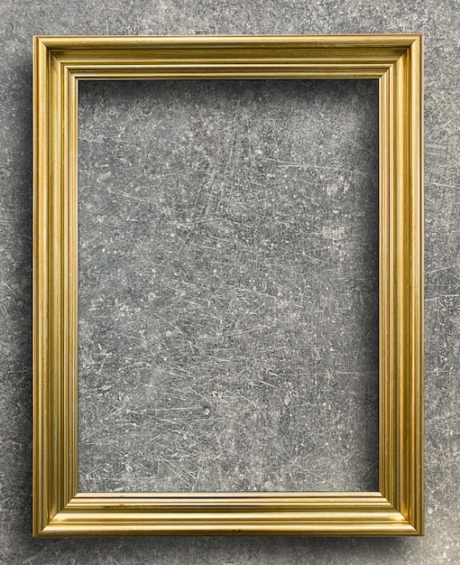 Marco dorado vintage en pared de cemento óxido Foto Premium